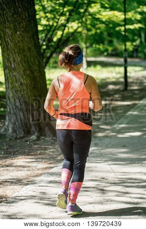 Young female jogger in park