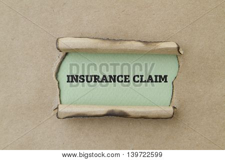 INSURANCE CLAIM written under torn paper concept.
