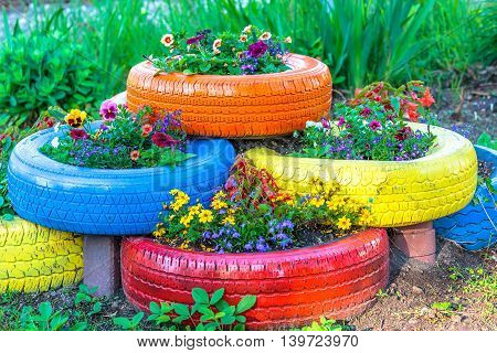 Painted tires being used as a flower planter.