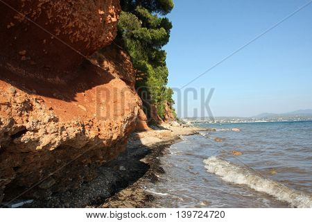 Red rocks on the coast of Aegean Sea close to Nikiti, Greece