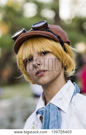 CAGLIARI, ITALY - May 29, 2016: Sunday at La Grande Jatte VIII Ed. At the Public Gardens - Sardinia - portrait of a beautiful girl in steampunk costume