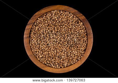Coriander Seeds In  Small Wooden Bowl