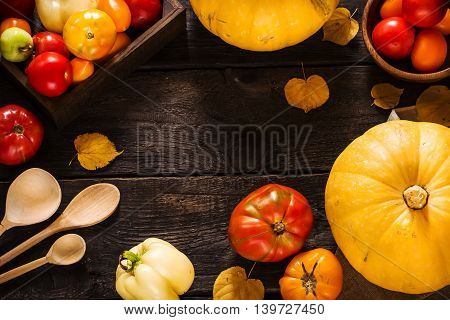 Autumn Nature Concept. Pumpkins And Tomatoes On Dark Wooden Table.