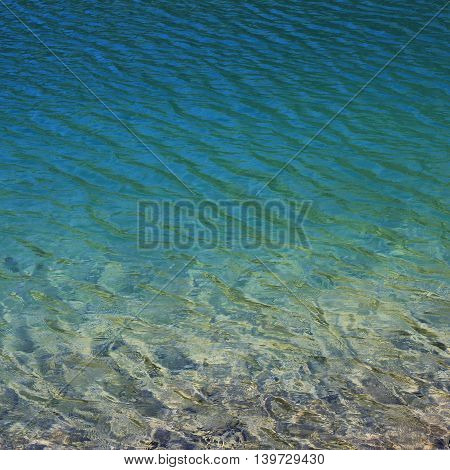 Clear and clean water of lake Klontal Swiss Alps. Nature background.