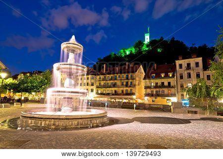 Ljubljana fountain and castle evening view capital of Slovenia