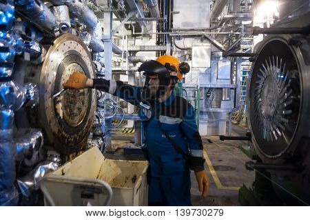 Tobolsk, Russia - July 15. 2016: Sibur company. Central control panel of Tobolsk Polymer plant. Industrial mechanic cleaning extruder machine