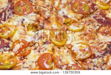 background meat pizza with vegetables close-up shot