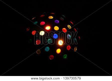 Party light disco ball on dark background