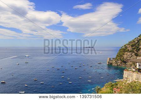 Summertime,Italy seascape: Amalfi Coast panorama (Costiera Amalfitana,Campania).Positano seaside: balcony with panoramic sea views. In the background a watchtower.