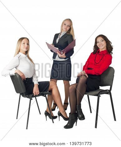 Three business women having a happy discussion at conference and sitting on chairs. Isolated on white background