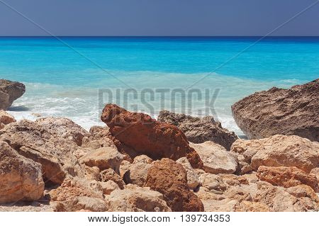 Rocky beach and  turquoise blue water of Ionian sea. Island of Lefkada, Greece. Vintage toned image