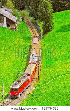 Passenger train moves from Chur to Arosa. Switzerland.