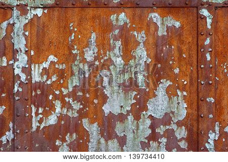 Grungy rusty texture with cracked and peeling paint