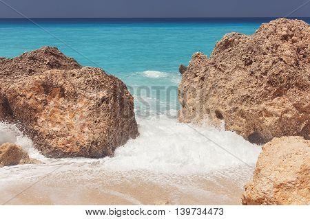 Kalamitsi beach,  Ionian Sea, Lefkada island, Greece.  Detail of breaking waves on beach. Vintage toned image