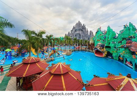 Ho Chi Minh city ( Saigon ) Vietnam - September 02 2015: People in outdoor swimming pool in children water park and historical theme amusement park Suoi Tien - popular travel destination in Vietnam.