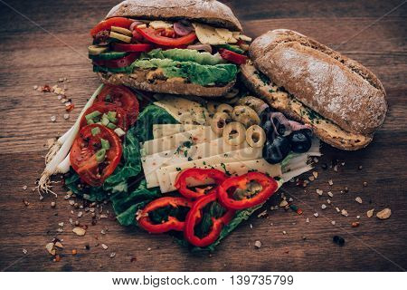 Messy Sandwich Overflowing With Ingredients.