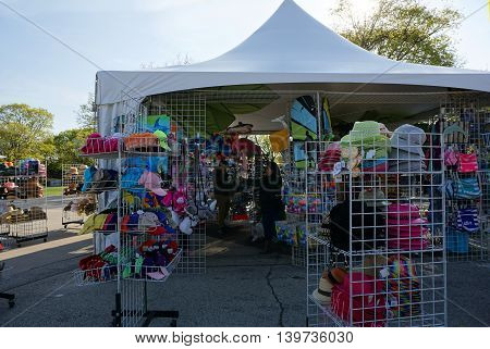 BROOKFIELD, ILLINOIS / UNITED STATES - APRIL 23, 2016: New hats fill racks outside of a sale tent at the Brookfield Zoo.