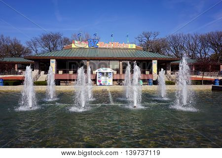 BROOKFIELD, ILLINOIS / UNITED STATES - APRIL 23, 2016: The BZ Red Hots restaurant is situated behind a fountain in the Brookfield Zoo.