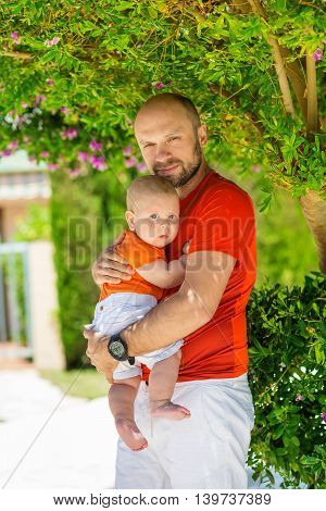 Father and his son under blooming tree