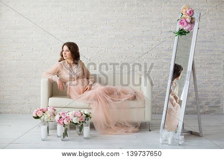 Portrait Of Beautiful Pregnant Woman In Studio