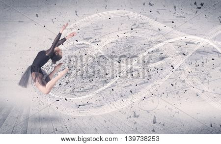 Performance ballet dancer jumping with energy explosion grungy particles concept on background