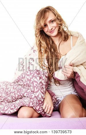Health and beauty concept. woman lying on mattress underneath the quilt and smiling Girl relaxing on her bed at morning