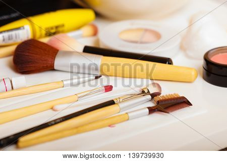Beauty and makeup. Make up set brushes and various decorative cosmetics on table