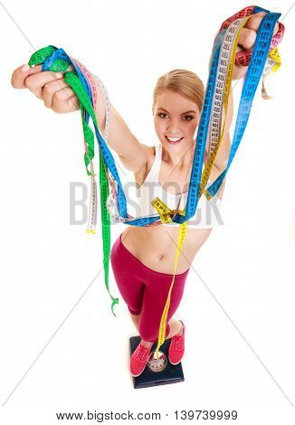 Happy Woman With Tape Measures On Weighing Scale.