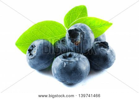 blueberry with green leaves isolated on white background