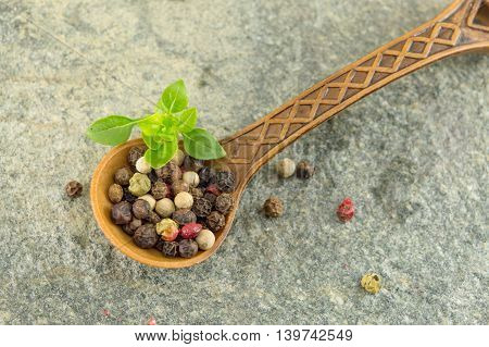 Pepper Spice Grains In A Wooden Spoon