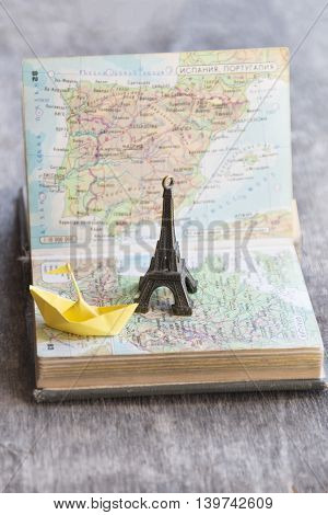 Travel , vacation, adventure idea. Preparing for your journey. Map and Eiffel Tower.
