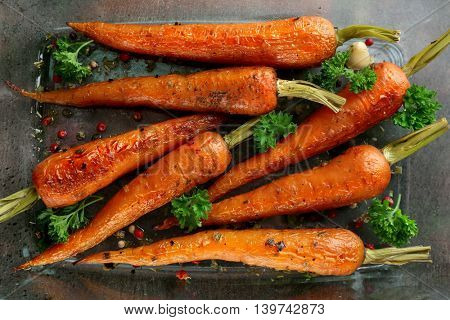 Tasty grilled carrots in glass bowl