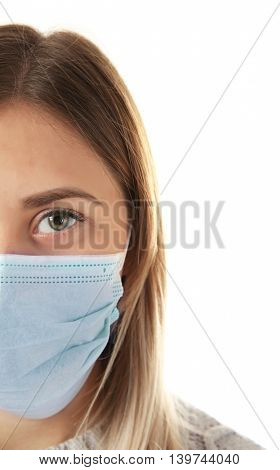 Ill woman wearing mask isolated on white, close up