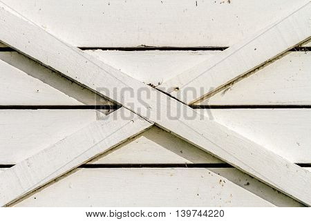 White rustic wood wall texture background with X cross