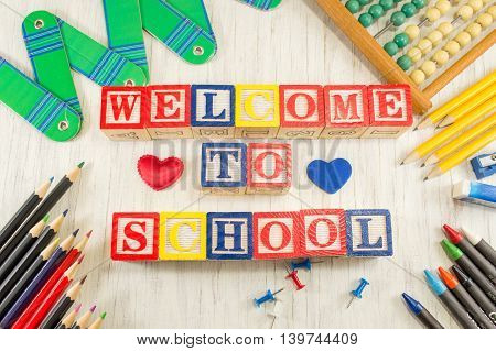 Welcome to school written with wooden cubicle letters