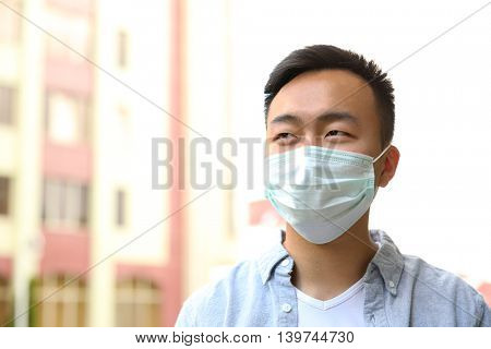 Ill man wearing mask on the street