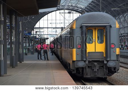 Trains in station Prague with people in summer time