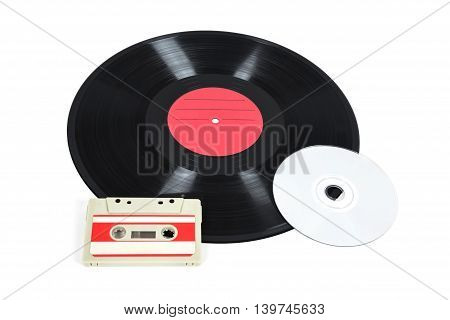 Music storage devices - vinyl record analog cassette and CD isolated on white background with clipping path
