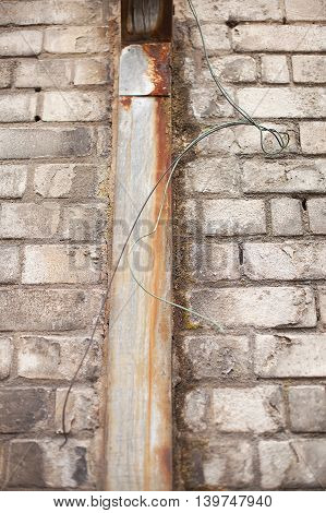 Rusty Drainpipe And Wire