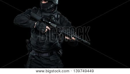 Spec ops police officer SWAT in black uniform studio