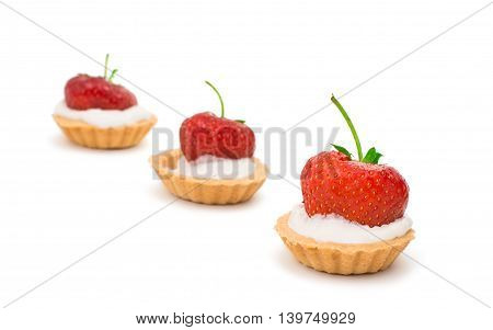 Tasty tartlet with strawberries isolated on white