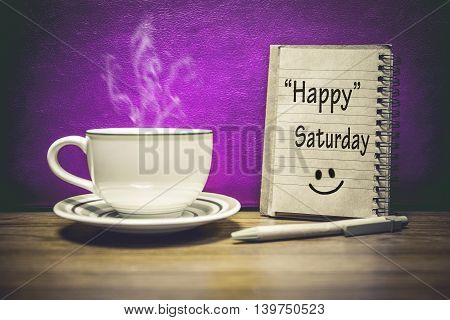 Inspirational quote - Happy Saturday on notepad retro style background.Focus Text message on notepad area .