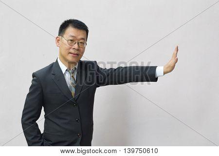 An asian man displaying a stop signal