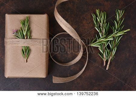 Present with Rosemary and burlap ribbon on a flat stone surface.