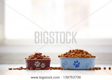 Dog food in bowls on table