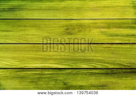 painted light green yellow planks as background