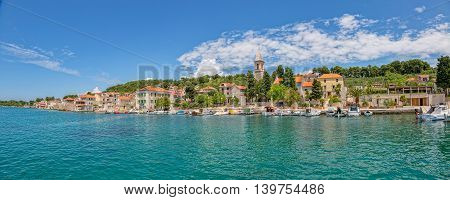 PRVIC LUKA, CROATIA - June 5, 2016 Panoramic picture of the small boats anchored in the town port at beautiful summer day.
