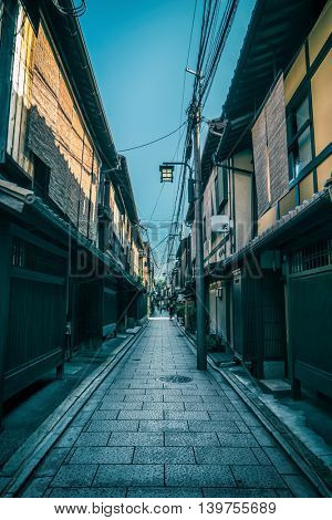 Kyoto - July 2016: Narrow lane with traditional Japanese houses at Gion
