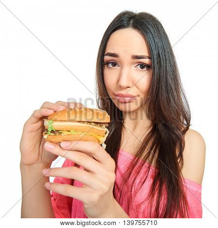 Young happy attractive woman with fast food. Unhealthy eating.