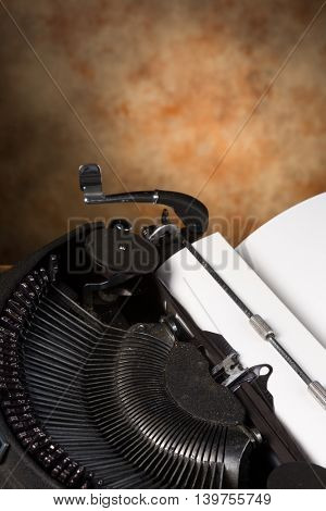 Dusty old antique typewriter with a blank page in it
